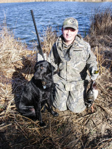 Lucas Brockman with Ozzie duck hunt